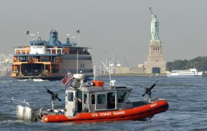 040901-C-4938N-077 A 25-foot Defender-class security boat from Coast Guard Maritime Safety and Security Team 91106 keeps an eye on passenger vessels and high profile landmarks as it patrols New York Harbor on Sept. 1, 2004. The U.S. Coast Guard is leading the multi-agency waterside security effort around Manhattan Island during the Republican National Convention. DoD photo by Petty Officer 3rd class Kelly Newlin, U.S. Coast Guard. (Released)
